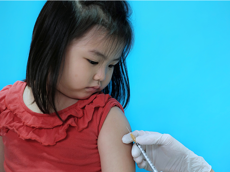 Young girl getting vaccinated