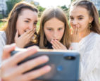 Girls looking at social media on their cell phone